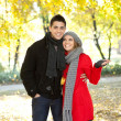 Young couple in autumn  park — Stock Photo #8512418