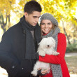 Young couple with dog — Stock Photo #8512429