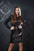 Glamorous woman in dark sequins dress — Stock Photo