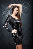 Girl wearing in sequin black dress — Stock Photo