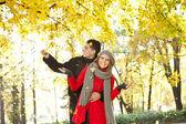 Young couple enjoying in autumn — Stock Photo