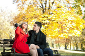 Young man courting a girl — Stock Photo