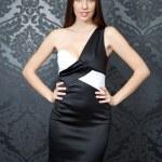 Beautiful woman in elegant dress — Stock Photo