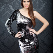 Elegant fashion woman sequins dress wallpaper — Stock Photo