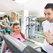 Trainer instructing mon treadmill — Stock Photo #8735350