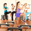 At the gym exercising with dumbbells — Stock Photo