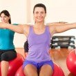 Girls in the gym exercise — Stock Photo