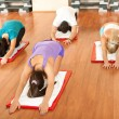 Group in fitness club relaxing and stretching — Stock Photo