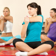 Women at the gym in a stretching class — Stock Photo