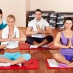 Group of doing yoga exercises — Stock Photo #8735486