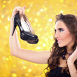 Fashion girl with pair of high heels — ストック写真