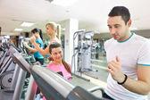 Trainer instructing man on treadmill — Stock Photo