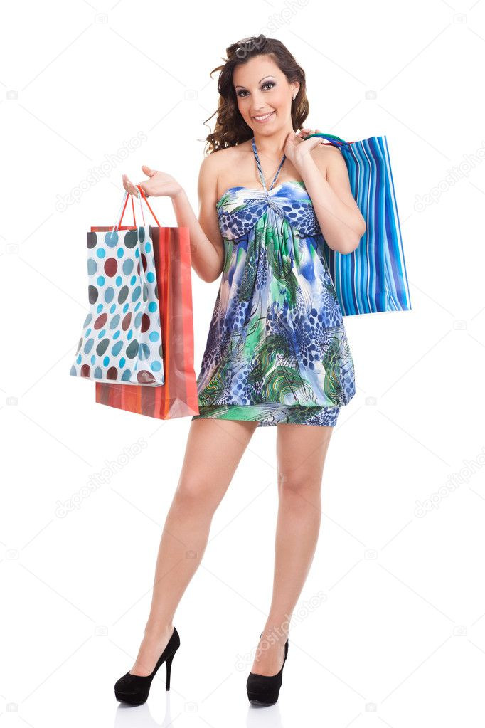 Shopping girl in summer dress with shopping bags, isolated on white background — Stock Photo #8735290