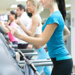 In gym on treadmill running - Foto Stock