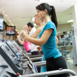 Young woman on treadmill — Stock Photo