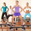 Healthy doing exercises at gym - Foto Stock