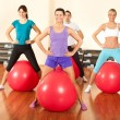 Group of doing  exercises in a gym — Stock Photo