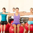 Group of doing exercises on fitness ball — Stock Photo