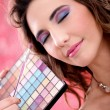 Professional make-up artist applying make-up on model — Stock Photo #8983796
