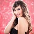 Young beauty on disco background — Stock Photo #8983909
