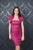 Woman in pink dress — Zdjęcie stockowe