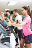 Young healthy exercising in gym — Stock Photo