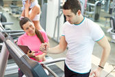 Female trainer with man on treadmill — Photo