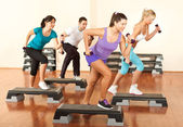 Stepping with dumbbells — Stock Photo