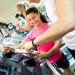 Young mwith instruction on treadmill — Stock Photo #9290918