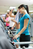 Sweating woman in gym — Stock Photo