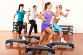 Step aerobics with dumbbells — Stockfoto