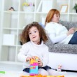 Girl playing on floor in living room — Stock Photo