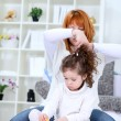 Hairstyle, mother and daughter — Stock Photo #9772502