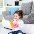 Girl and her favorite soft toy - Stock Photo