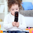 Royalty-Free Stock Photo: Baby girl playing with mobile phone