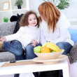 Stock Photo: Mother and daughter in living room