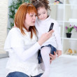 Royalty-Free Stock Photo: Mother  and daughter using cell phone