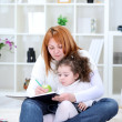 Mother and daughter have fun together — Stock Photo