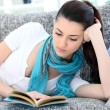 Stock Photo: Pretty woman reading book