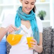 Smiling woman with juice — Stock Photo