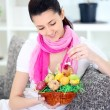 Smiling woman choosing Easter eggs — Stock Photo #9775012