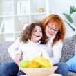 Woman playing  with her little daughter — Stock Photo