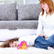 Happy mother with a daughter at home — Stock Photo