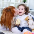 Stock Photo: Mother kissing daughter