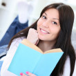 Happy young woman studying — Stock Photo #9775184