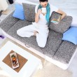 Relaxation woman with tea and book in living room — 图库照片