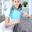 Young woman enjoying in book — Foto Stock