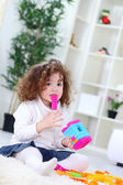 Baby playing with colorful blocks — Stock Photo