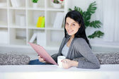 Beautiful woman writing in a notepad — Stock Photo