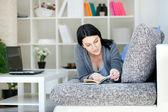 Women Reading a Book on Sofa — Stock Photo